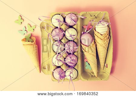 Easter or Spring Food Concept. Fresh Eggs in Box for Eggs with Ice Cream Cones on Pink Pastel Background. Top View. Pastel Toning.