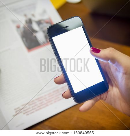 Woman Scanning Page From A Magazine With Smartphone