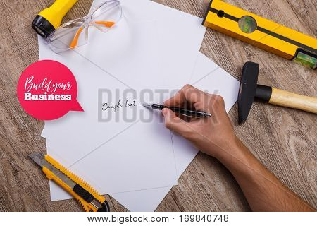 Hammer, knife and protective glasses. Build your business speech bubble. Flashlight, building level and blank sheets of paper. Architect hand.