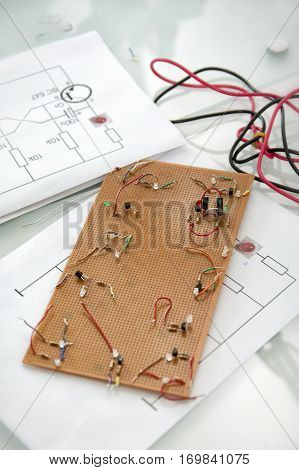Building Curcuit Board With Schematics On The Table