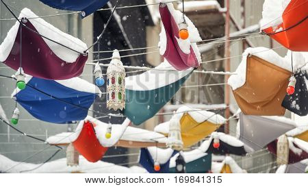 Snow On The Decorative Hangings At The Street