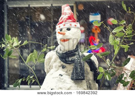 Snowman With Hat And Scarf At The Street