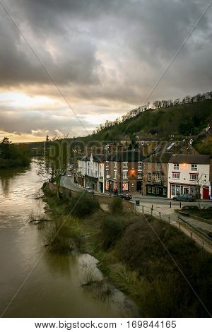 IRONBRIDGE UK - 14 FEBRUARY 2005: A view of the Shropshire town of Ironbridge on the banks of the River Severn on a grey and overcast evening.