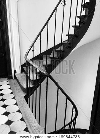 Old staircase in Paris, vintage tilling in black and white