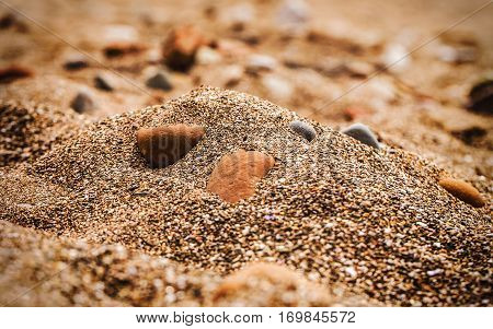 Gravel sand and stones on the golden beach