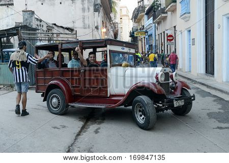 People On Board Of An Oldtimer Taxi