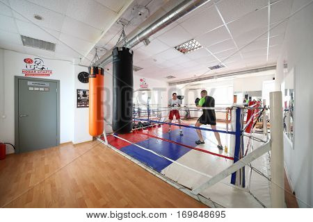 MOSCOW - MAR 25, 2016: Two man fight in modern gym New Sparta with boxing ring, In addition to standard set of fitness services New Sparta offers classes with champion - highly qualified trainers