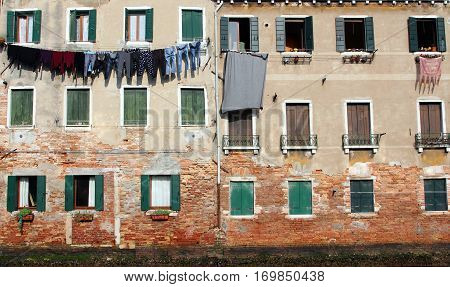 Underwear Drying On The Wall Of The Old Stone House, Venice, Italy
