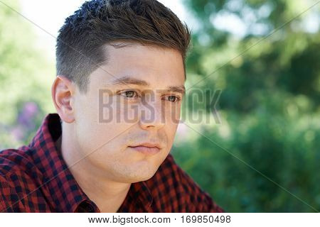 Head And Shoulders Outdoor Portrait Of Concerned Man