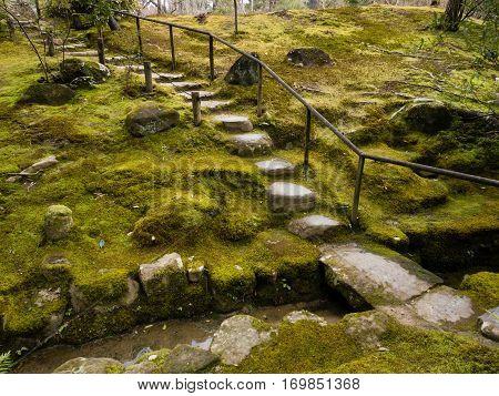 Nara, Japan - March 13, 2013: Japanese moss garden with stone path - in Isuien garden, Nara