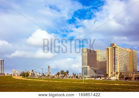 TEL AVIV, ISRAEL - JANUARY 1, 2016: Skyscrapers on the waterfront in Tel Aviv. Windy and bright winter day at the seaside