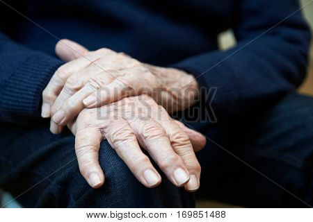 Close Up Of Senior Man Suffering With Parkinsons Diesease
