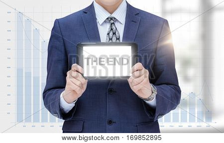 Businessman Shows Tablet With The Inscription The End On A Background Of Loss.