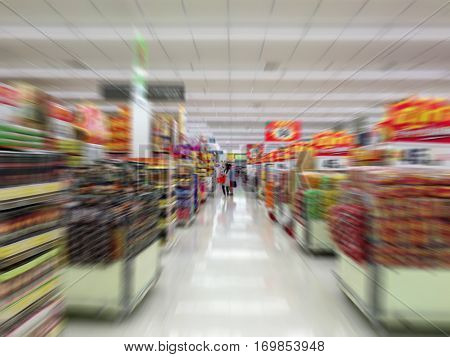 Supermarket Aisle and Shelves in motion blur for background