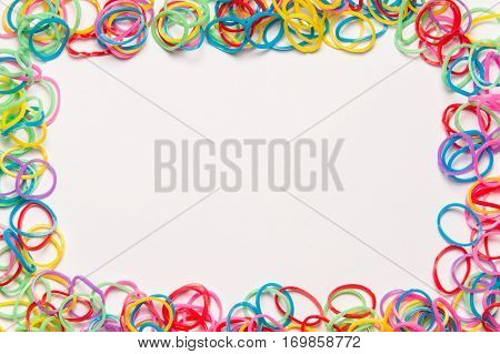 Colorful rubber bands on white background. Office supplies. Assortment of stationery.