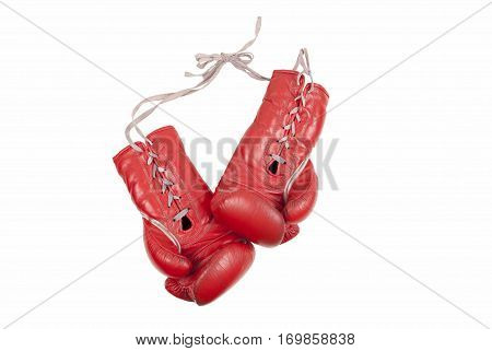 old used and battered red leather boxing gloves with laces isolated on white background