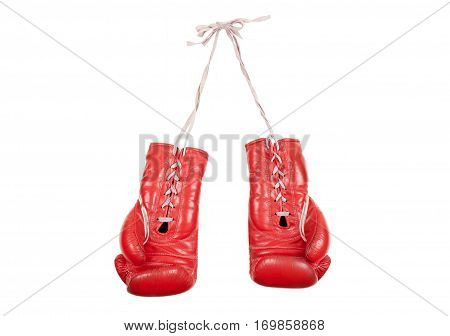 old used and battered red leather boxing gloves isolated on white background