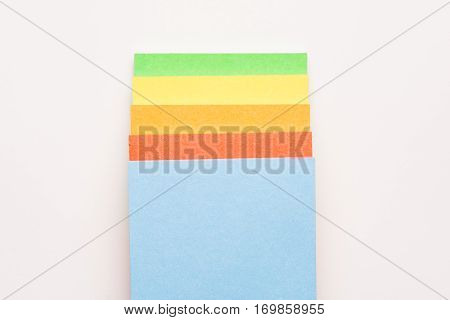 Colorful notepaper isolated on white background. Miscellaneous office supplies. Assortment of stationery.