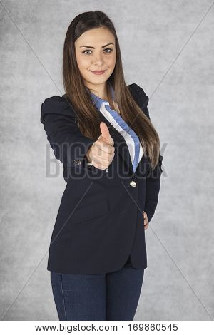 Portrait Of A Beautiful Young Business Woman With Thumbs Up Celebrating