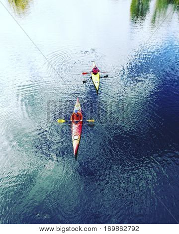 A couple kayaking on Crescent Lake in Olympic Park USA