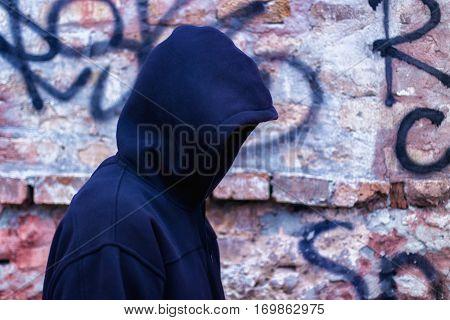 Hacker against a brick wall concept design illustration banner
