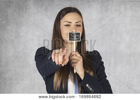 Business Woman Covers Her Mouth With A Dollar Sign, Indicating You