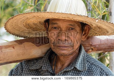 70-79 Years Portrait of friendly senior asian adult man with straw hat