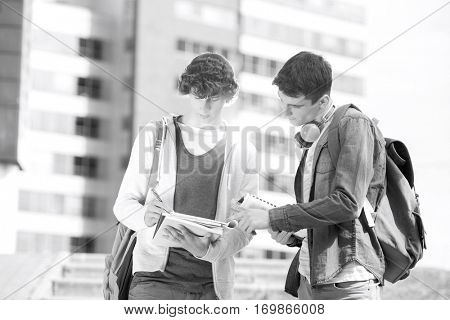 Young male college students studying at campus