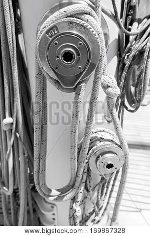 Ropes wound around winches on sailboat