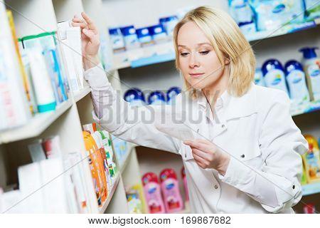 pharmaceutist woman worker in drug store