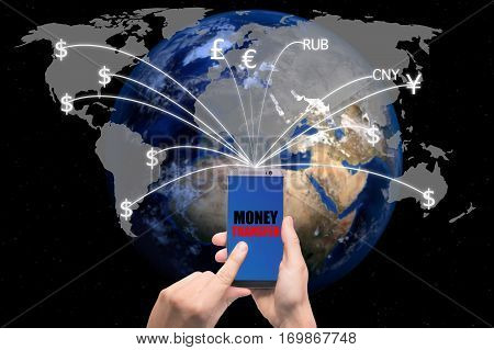 Hand holding smart phone sent money flying away from screen to global map. Technology online banking money transfer e-commerce concept.