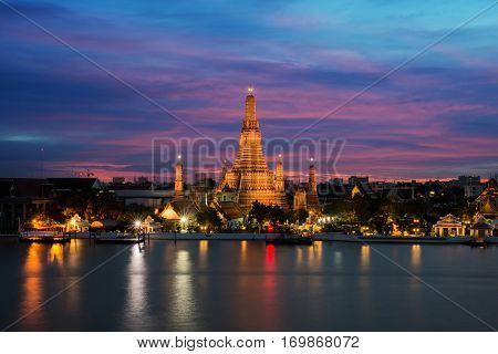 Wat Arun temple and Chao Phraya River at night in Bangkok Thailand