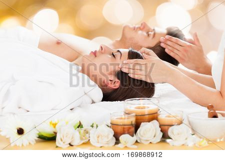 Close-up Of A Young Couple Receiving Head Massage At Beauty Spa