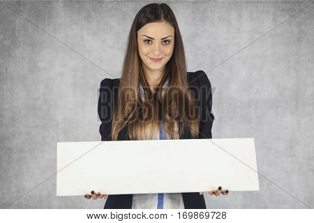 Smiling Business Woman Holds A Place For Your Ad