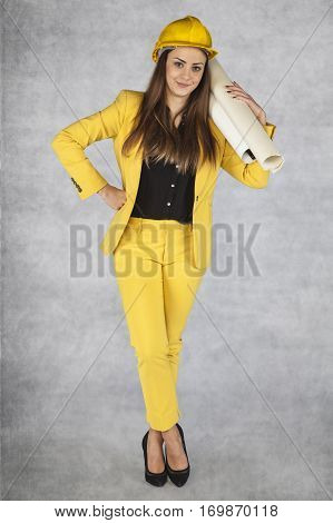 Smiling Business Woman Holding Plans