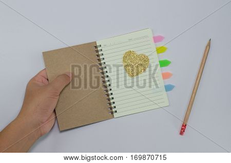 Writer recycled paper notebook open front cover on white background