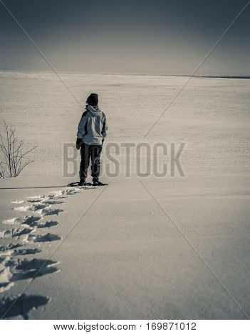 Person snowshoeing in the winter in prince edward island