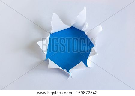 Torn paper with blue background design concept.