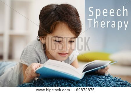 Little boy with book at home. Text SPEECH THERAPY on background