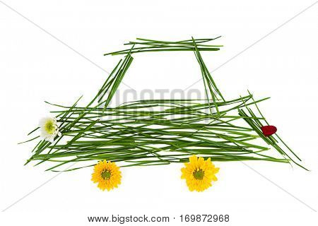 Ecological car made of grass and flowers for environmental conservation concept isolated on white background.