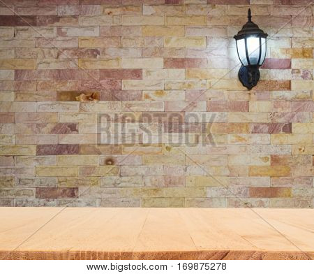 Empty Wooden Table On Modern Stone Wall With Lantern
