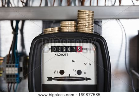 Close-up Of A Stacked Coin Measuring On Kilowatt Electricity Meter