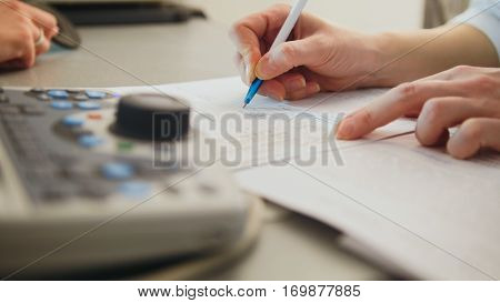 Ophthalmology - doctor writes a report of the diagnosis, close up