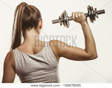 Strong Woman Lifting Dumbbells Weights. Fitness.