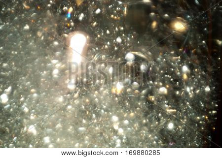 Many small air bubbles rising in golden champagne