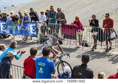 Mont Ventoux France- July 14 2013: The French cyclist Alexis Vuillermoz (Sojasun Team) climbing the last kilometer of the ascension to Mont Ventoux during the stage 15 of the 100 edition of Le Tour de France 2013.
