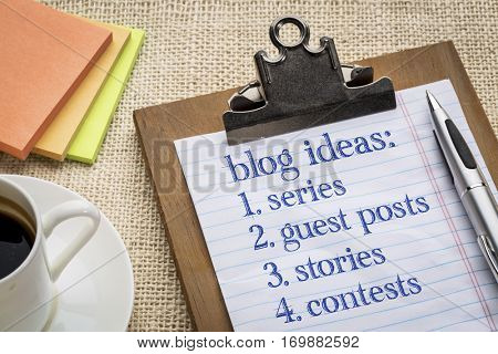 Blogging ideas list (series, guest post, stories, contests) on a clipboard with a cup of espresso coffee