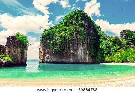 Beautiful beach. View of nice tropical beach with palms around. Holiday and vacation concept. Tropical beach. Beautiful tropical island in Thailand.