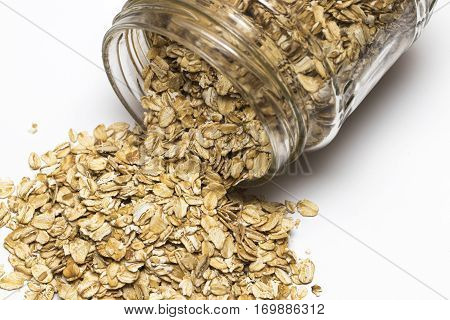Glass Jar With Rolled Oats Isolated On White Background
