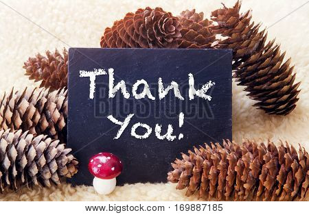 pinecones and black chalkboard with the words Thank You